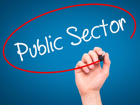 Man Hand writing Public Sector with white marker on visual screen. Isolated on background. Business, technology, internet concept. Stock Photo