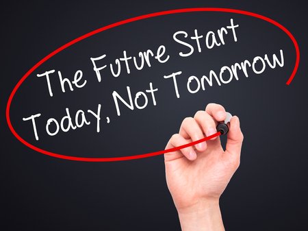 Man Hand writing The Future Start Today, Not Tomorrow with white marker on visual screen. Isolated on background.