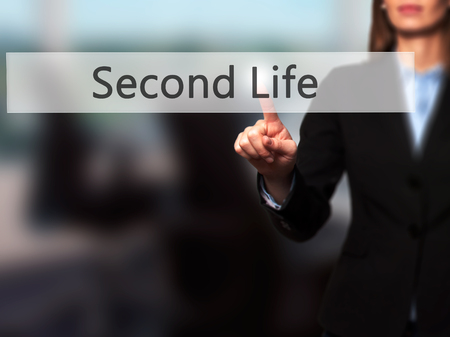 Second Life - Businesswoman hand pressing button on touch screen interface. Business, technology, internet concept. Stock Photo