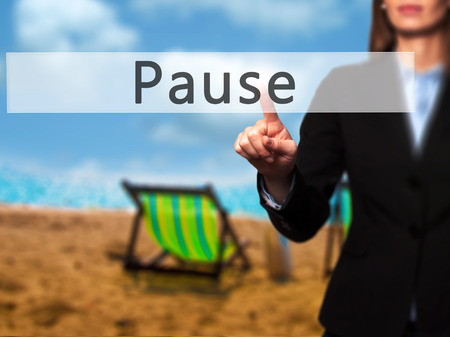 Pause - Businesswoman hand pressing button on touch screen interface. Business, technology, internet concept. Stock Photo