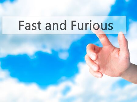 Fast and Furious - Hand pressing a button on blurred background concept