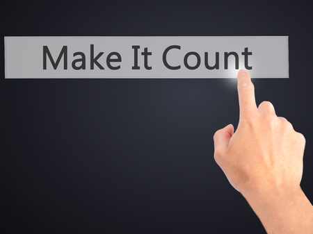 Make It Count - Hand pressing a button on blurred background concept . Business, technology, internet concept. Stock Photo