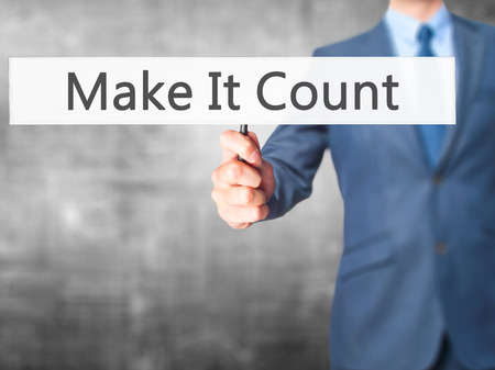 Make It Count - Businessman hand holding sign. Business, technology, internet concept. Stock Photo