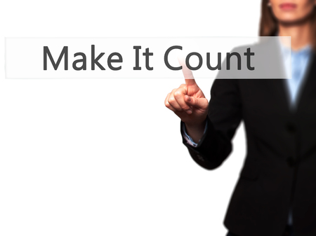 Make It Count - Businesswoman hand pressing button on touch screen interface. Business, technology, internet concept. Stock Photo