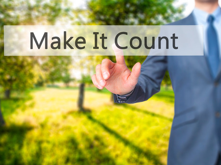 Make It Count - Businessman hand pressing button on touch screen interface. Business, technology, internet concept. Stock Photo
