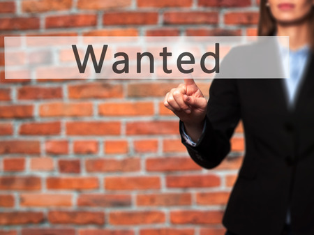 Wanted - Businesswoman hand pressing button on touch screen interface. Business, technology, internet concept. Stock Photo
