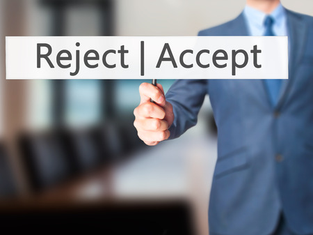 Accept  Reject - Businessman hand holding sign. Business, technology, internet concept. Stock Photo