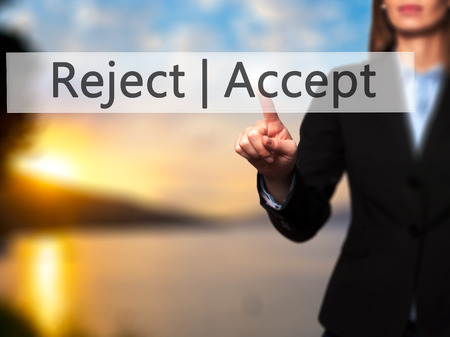 Accept  Reject - Businesswoman hand pressing button on touch screen interface. Business, technology, internet concept. Stock Photo