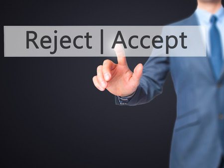 Accept  Reject - Businessman hand pressing button on touch screen interface. Business, technology, internet concept. Stock Photo