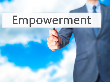 Empowerment - Businessman hand holding sign. Business, technology, internet concept. Stock Photo