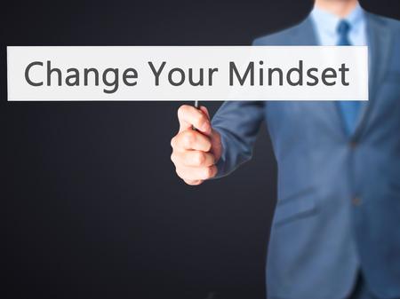 Change Your Mindset - Businessman hand holding sign. Business, technology, internet concept. Stock Photo