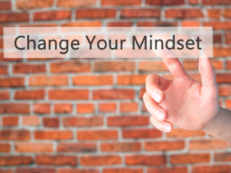 Change Your Mindset - Hand pressing a button on blurred background concept . Business, technology, internet concept. Stock Photo