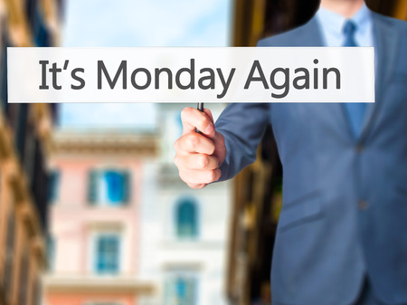 It's Monday Again - Businessman hand holding sign. Business, technology, internet concept. Stock Photo