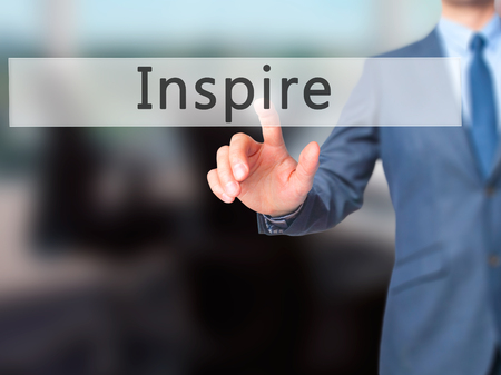 Inspire - Businessman hand pressing button on touch screen interface. Business, technology, internet concept. Stock Photo