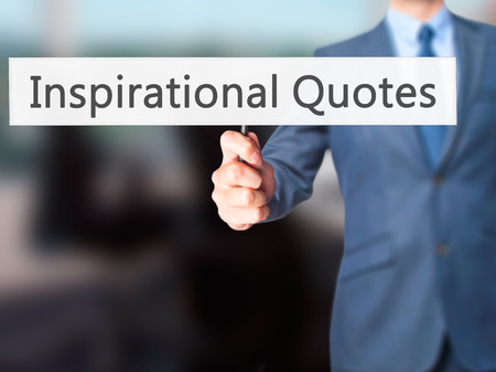 Inspirational Quotes - Businessman hand holding sign. Business, technology, internet concept. Stock Photo