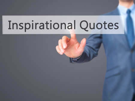 Inspirational Quotes - Businessman hand pressing button on touch screen interface. Business, technology, internet concept. Stock Photo