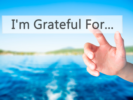 I'm Grateful For... - Hand pressing a button on blurred background concept . Business, technology, internet concept. Stock Photo
