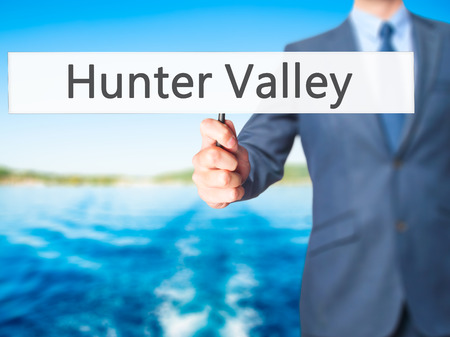Hunter Valley - Businessman hand holding sign. Business, technology, internet concept. Stock Photo