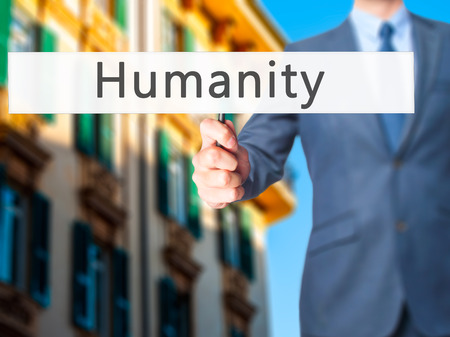 Humanity - Businessman hand holding sign. Business, technology, internet concept. Stock Photo