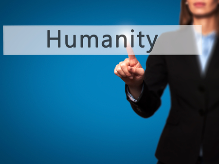 Humanity - Businesswoman hand pressing button on touch screen interface. Business, technology, internet concept. Stock Photo