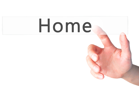 Home - Hand pressing a button on blurred background concept . Business, technology, internet concept. Stock Photo