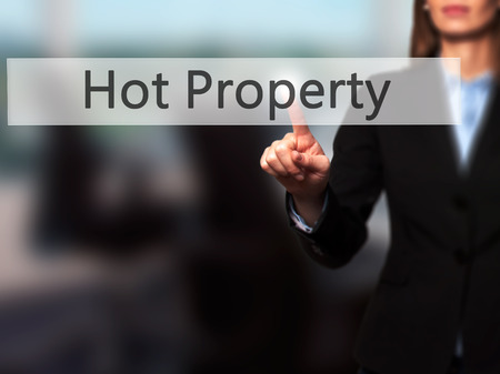 Hot Property - Businesswoman hand pressing button on touch screen interface. Business, technology, internet concept. Stock Photo