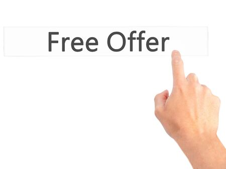 Free Offer - Hand pressing a button on blurred background concept . Business, technology, internet concept. Stock Photo