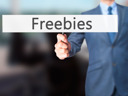 Freebies - Businessman hand holding sign. Business, technology, internet concept. Stock Photo