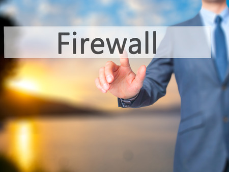 Firewall  - Businessman hand pressing button on touch screen interface. Business, technology, internet concept. Stock Photo