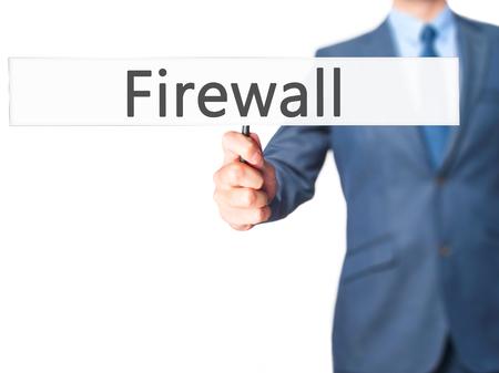 Firewall  - Businessman hand holding sign. Business, technology, internet concept. Stock Photo