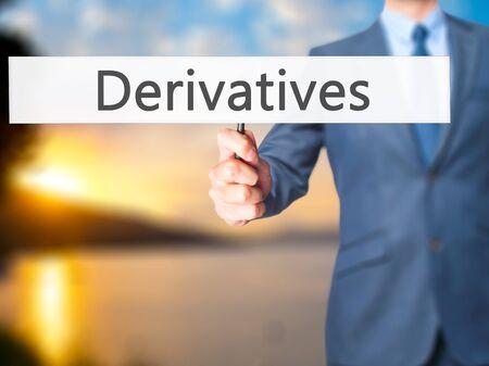Derivatives - Businessman hand holding sign. Business, technology, internet concept. Stock Photo