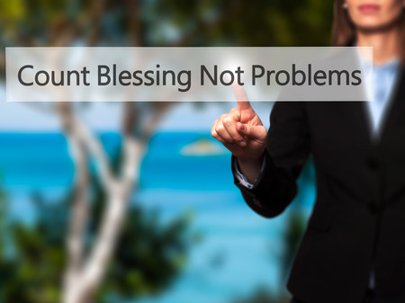 Count Blessing Not Problems -  Successful businesswoman making use of innovative technologies and finger pressing button. Business, future and technology concept. Stock Photo