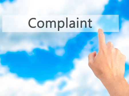 Complaint - Hand pressing a button on blurred background concept . Business, technology, internet concept. Stock Photo
