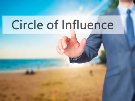 Circle of Influence - Businessman hand pressing button on touch screen interface. Business, technology, internet concept. Stock Photo