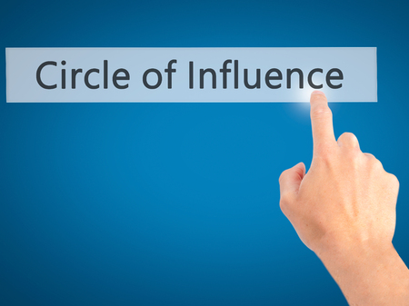 Circle of Influence - Hand pressing a button on blurred background concept . Business, technology, internet concept. Stock Photo