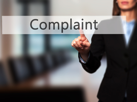 Complaint -  Successful businesswoman making use of innovative technologies and finger pressing button. Business, future and technology concept. Stock Photo