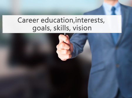 Career education, interests, goals, skills, vision - Business man showing sign. Business, technology, internet concept. Stock Photo