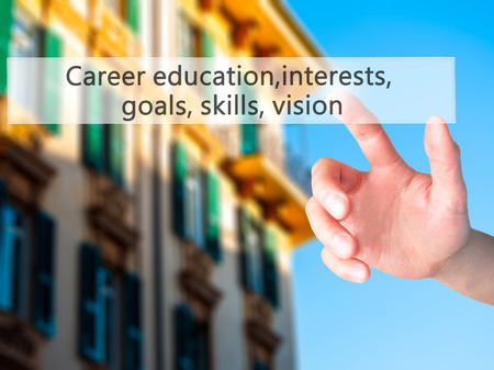 Career education, interests, goals, skills, vision - Hand pressing a button on blurred background concept . Business, technology, internet concept. Stock Photo