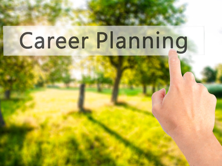 Career Planning - Hand pressing a button on blurred background concept . Business, technology, internet concept. Stock Photo