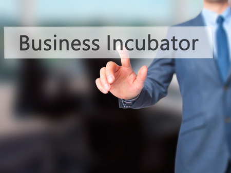 Business Incubator - Businessman click on virtual touchscreen. Business and IT concept. Stock Photo