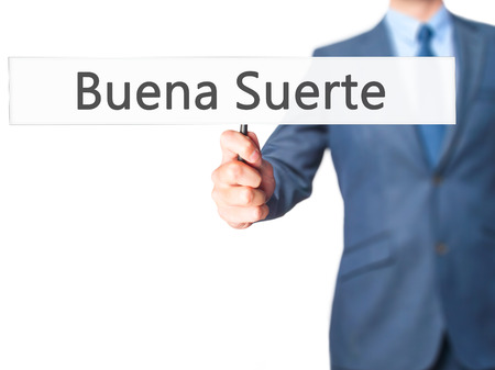 Buena Suerte ( Good Luck in Spanish) - Business man showing sign. Business, technology, internet concept. Stock Photo