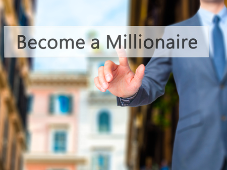 Become a Millionaire - Businessman hand pushing button on touch screen. Business, technology, internet concept. Stock Image