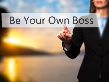 Be Your Own Boss -  Successful businesswoman making use of innovative technologies and finger pressing button. Business, future and technology concept. Stock Photo