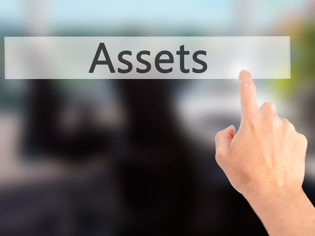Assets - Hand pressing a button on blurred background concept . Business, technology, internet concept. Stock Photo