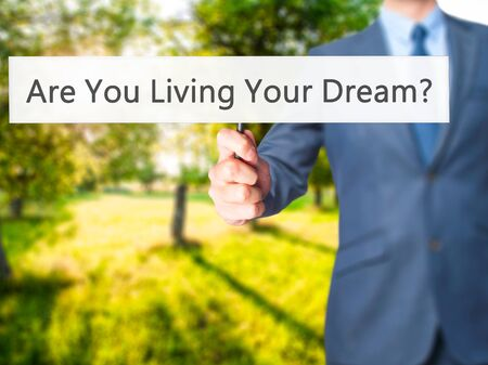 Are You Living Your Dream ? - Business man showing sign. Business, technology, internet concept. Stock Photo