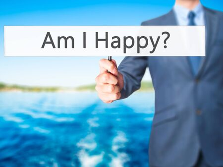 Am I Happy ? - Business man showing sign. Business, technology, internet concept. Stock Photo