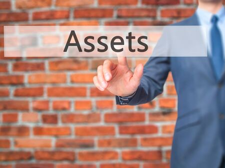 Assets - Businessman press on digital screen. Business,  internet concept. Stock Photo