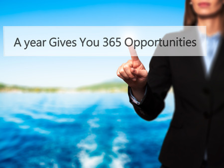 A year Gives You 365 Opportunities - Isolated female hand touching or pointing to button. Business and future technology concept. Stock Photo
