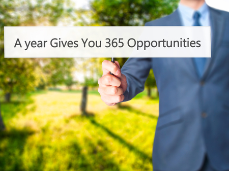 A year Gives You 365 Opportunities - Business man showing sign. Business, technology, internet concept. Stock Photo