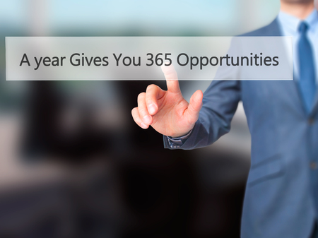 A year Gives You 365 Opportunities - Businessman press on digital screen. Business,  internet concept. Stock Photo